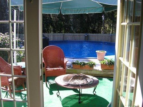 view from french doors to the deck and pool area - Spacious Luxury Private fenced Pool home - Inverness - rentals