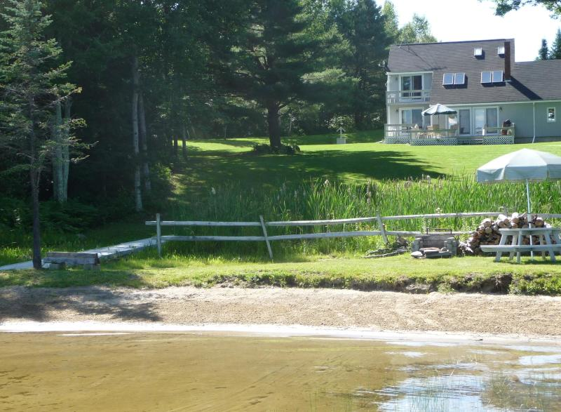 View of the lake, beach, lawn and house from the lake. - PRIVATE WATERFRONT 3 BDR Home with sandy beach! - North Monmouth - rentals