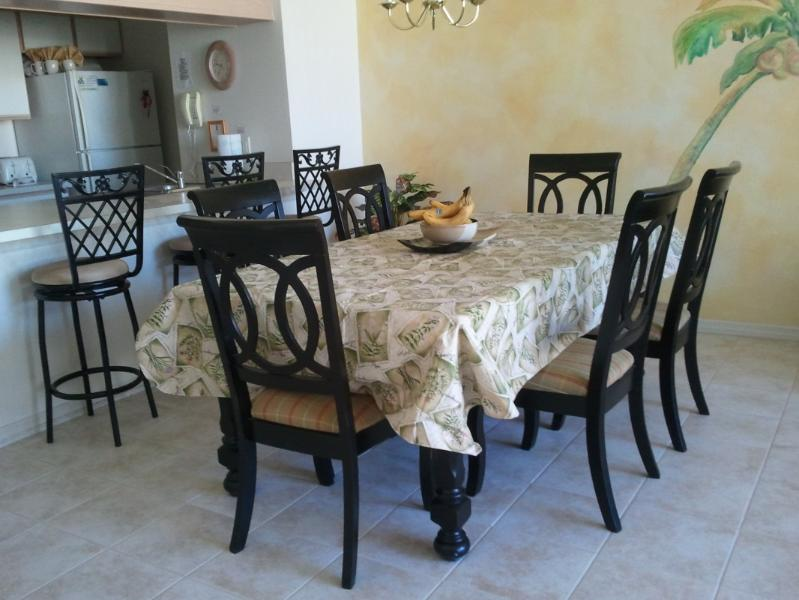 Dining room with tiled flooring - Disney Vacation Condo - stay 6 days get 7th FREE - Four Corners - rentals