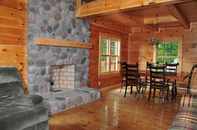 great room with stone fire place - CONNER HOMESTEAD LODGE - Logan - rentals