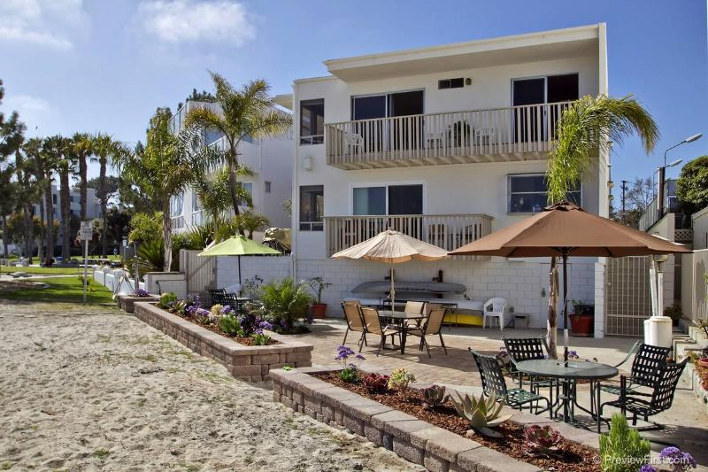 Enjoy the bay views from the lower common patio. Both balconies are yours, too! - La Palma Grande Views...on the sand in sunny SD - San Diego - rentals