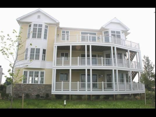 condo exterior side -second floor - Luxury vacation condominum with private beach - Chester - rentals