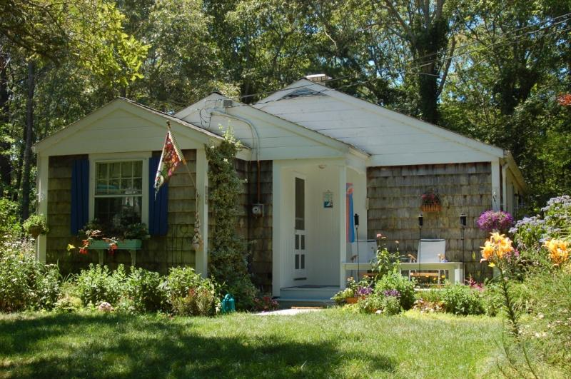 North end by driveway.  Hummingbirds in summer right by the porch. - Charming 3 bedroom cottage near sandy beach - Centerville - rentals