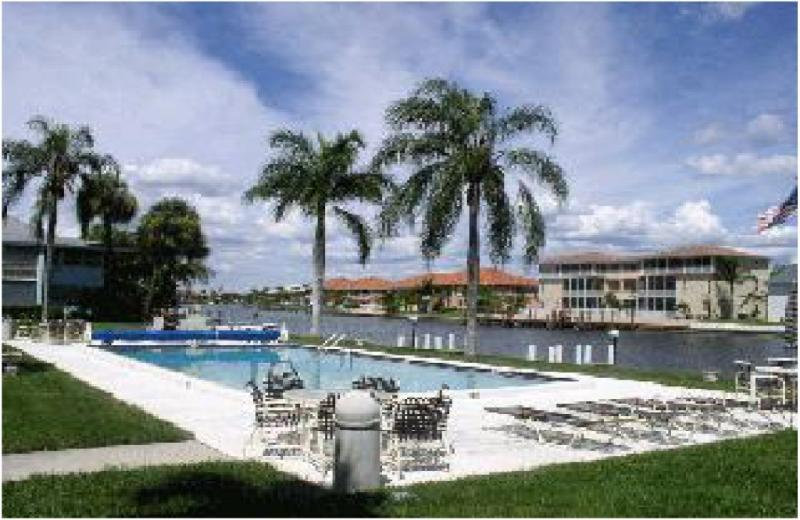 Pool area w. sun lounges, BBQ grill - Gulf Access condo 1 BDR. large pool, boat dock - Cape Coral - rentals