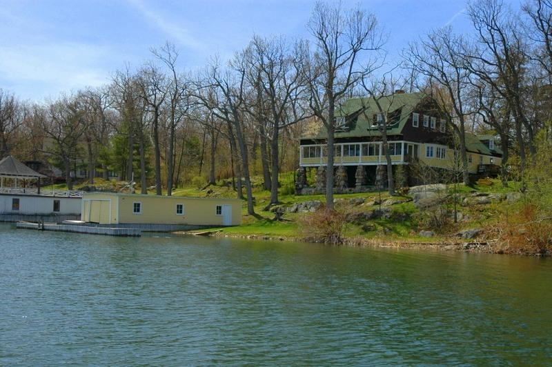 View of house in the Spring - Gorgeous 6 BR House on the Water - Wellesley Island - rentals