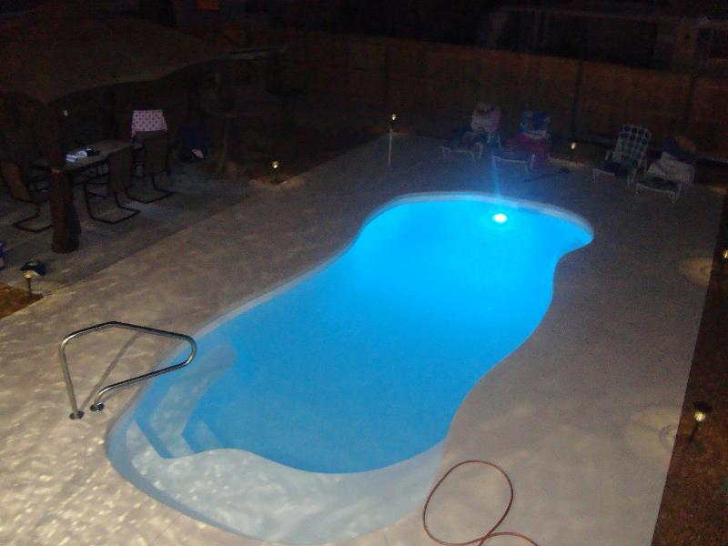 Night time view of your private salt water backyard pool! - Stunning Home with Backyard Pool Oasis - Saint Pete Beach - rentals