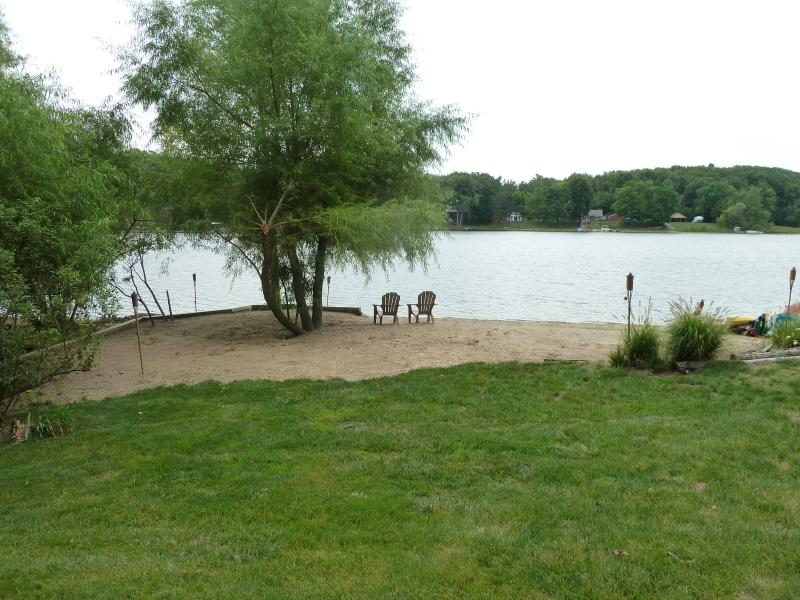 The beach at White Oak Point.  The beach chairs are facing the sunrise. - White Oak Point Lake Retreat - Delton - rentals