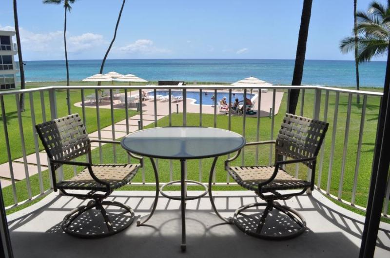 Lovely view from the apartment lanai, overlooking pool, courtyard and beach. - Beachfront condo in Maili Cove, Oahu, Hawaii - Waianae - rentals