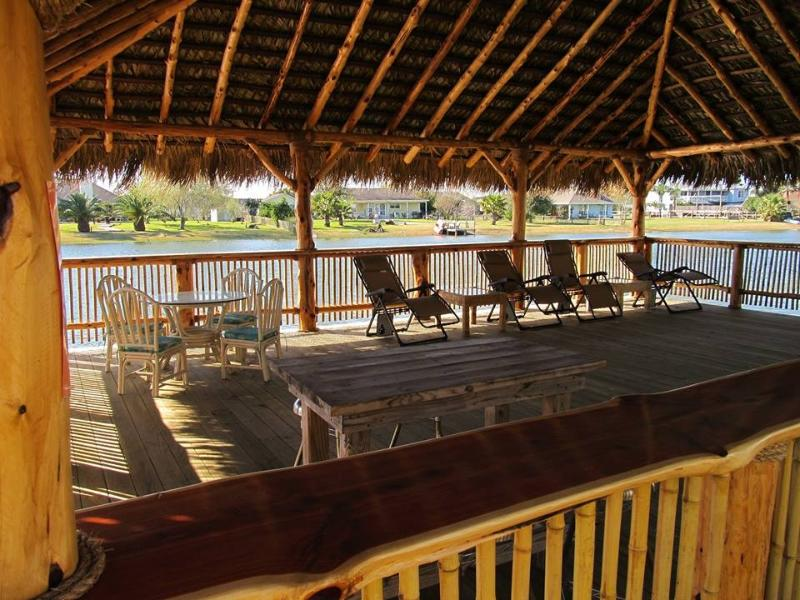 Relax on the outdoor palapa by the water... - Tropicali Cove - Villa Near Kemah & Galveston Bay - San Leon - rentals