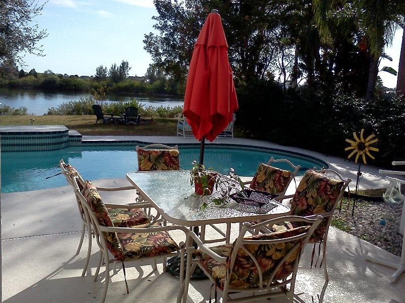 Relax by the waterfront pool in your private backyard. - Private Waterfront Home with Heated Pool and Canoe - Tarpon Springs - rentals