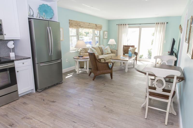 Living area in unit A, one bedroom unit. There is a queen sleep sofa and bedroom - Siesta Key, Sarasota, One Bedroom, Steps to Beach. - Siesta Key - rentals