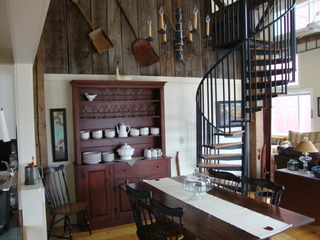 The dining room.  Spiral staircase leading to loft area with two twin beds. - Beautifully Renovated and Furnished Post and Beam - Cambridge - rentals