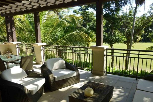 Soak in the tropical sunshine on the large terrace over the golf course. - Elegant Modern Villa at Bahia Beach - Rio Grande - rentals