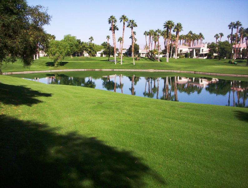 Watch golfers play the 7th hole of the Arnold Palmer Course at PGA West. - Gorgeous Palmer Course Condo at PGA West - La Quinta - rentals