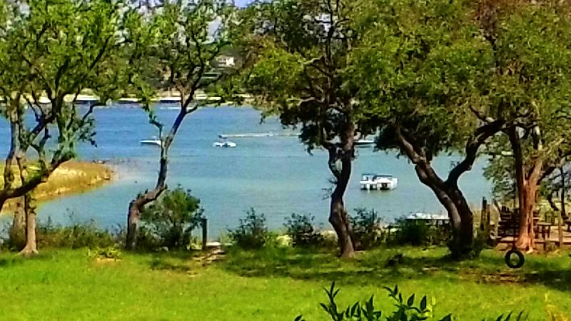 Taken from main floor deck; 6/2015-The lake is right in the back yard! - LAKESIDE TOWNHOUSE WITH DIRECT ACCESS TO THE WATER - Lake Travis - rentals