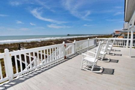 Dolphins dancing in the sparkling Atlantic... 1000 feet from the pier - Oceanfront luxury 6 bedroom home in N Myrtle Beach - North Myrtle Beach - rentals