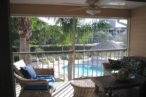 Lanai view of pool, tiki hut. Only 15 condos in Seabury-pool all yours & often! - 2bd 2BA-Walk to S. Beach-week of Jan 7 still avail - Marco Island - rentals