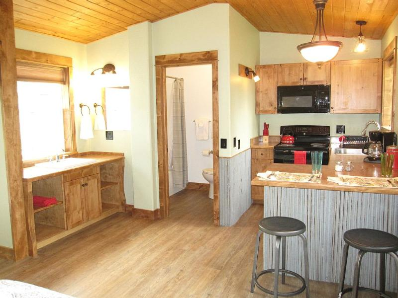 Cabin interior looking into kitchen. - Minutes From Glacier Park-Super Clean Cabin - Columbia Falls - rentals