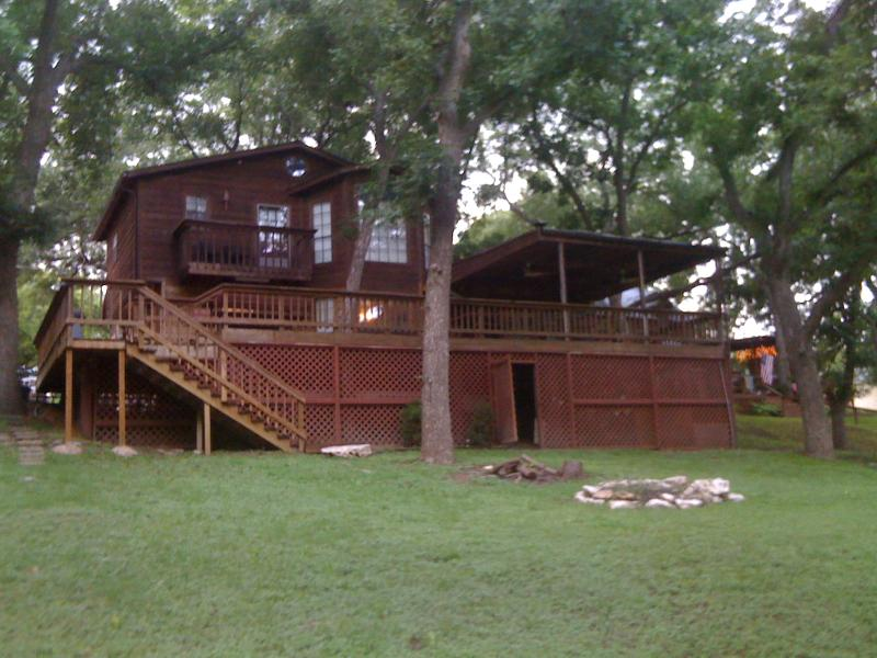 Large backyard of pecan trees with outdoor patio and firepit - Lil' Ponderosa Luxury Home Rental on the Guadalupe - Canyon Lake - rentals