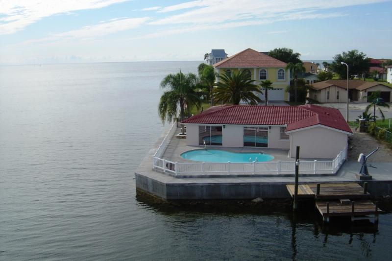 Rear View of home:  pool, boat dock and surrounding water - Water Views from Every Room on the Gulf of Mexico - Hudson - rentals