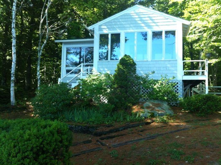 camp from the lake.... great porch to sit at with a great view of the lake! - Thompson Lake 4-season Cottage - Casco - rentals