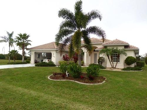 Front of house with double car garage - gulf custom built vacation home rental - Arcadia - rentals