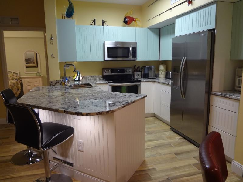 Fully equipped kitchen, granite countertops, porcelain floors, new SS appliances - Beautiful 2 Bed Condo Gardens at Beachwalk - Fort Myers - rentals
