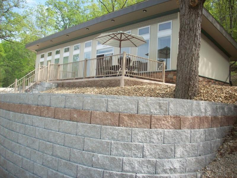 Front of house with patio, umbrella, and eight chairs - New Three Bedroom House With  Boat Dock and WIFI - Lake Ozark - rentals