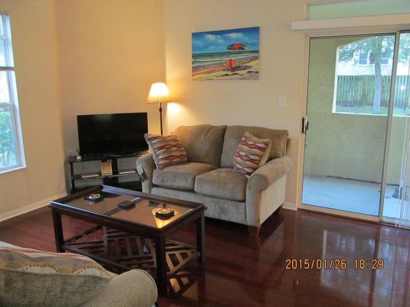 Living room and door to covered porch - Condo Sold - No longer available - Clearwater - rentals