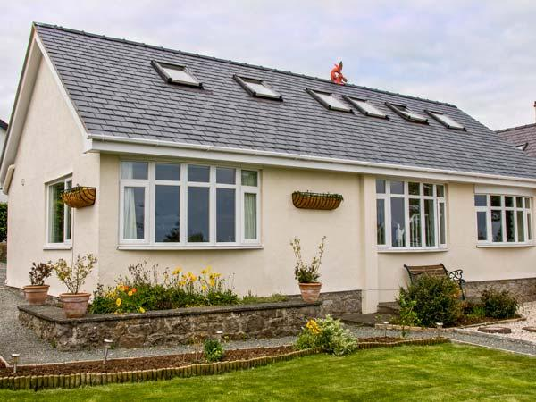 JASMINE COTTAGE, detached seaside cottage with hot tub, flexible accommodation, near beach in Benllech, Ref 906143 - Image 1 - Benllech - rentals