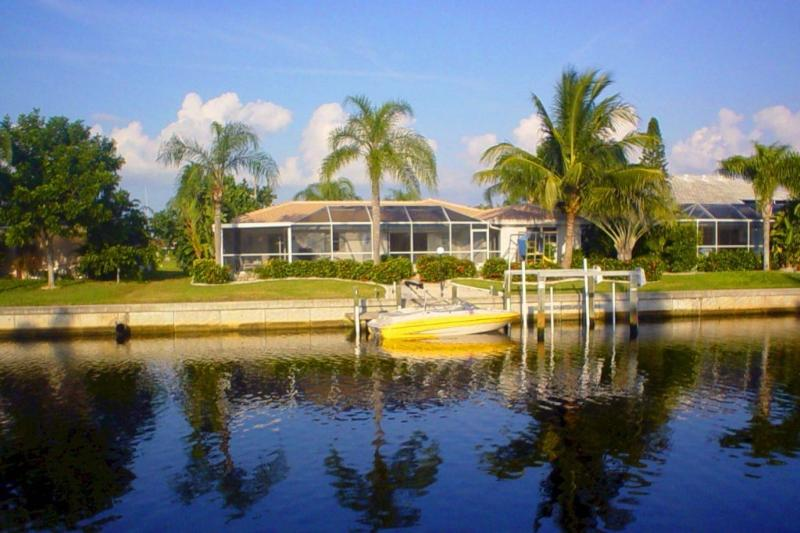 Palm Villa from the water - Superb waterfront home with  boat dock & pool - Punta Gorda - rentals