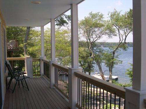Porch looking over the water and beach to the side offers beautiful sunsets - Waterfront Cape Cod Home on John's Pond - Mashpee - rentals