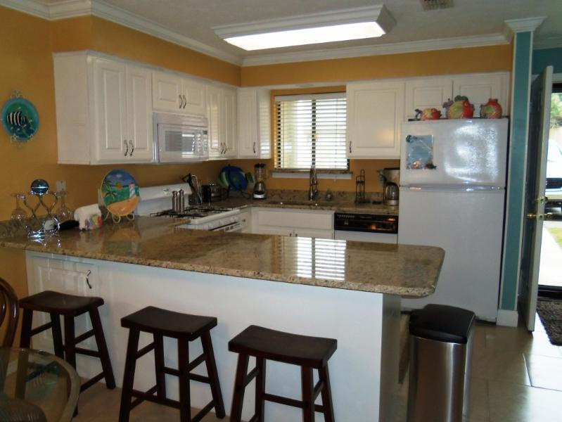 Fully stocked kitchen with new granite countertops - Gulf Highlands Beach Resort - 2 bedroom 2.5 bath - Panama City Beach - rentals