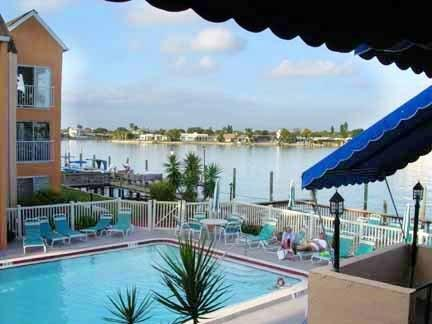 Pool-View from Community Room - BEAUTIFUL CONDO ON THE SCENIC BOCA CIEGA BAY ! - Saint Pete Beach - rentals