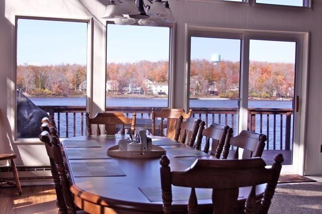Dining room with full view of the lake. - Lake front with hot tub, pool table, canoe - 5 BR - Tobyhanna - rentals