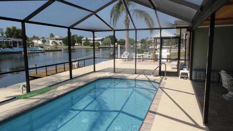 Solar Heated Pool that is part of a large outside porch & entertainment area. - Hernando Beach - Screened Lanai & Pool - Boat Dock - Hernando Beach - rentals