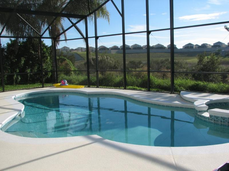 Beautiful south facing swimming pool overlooking Star Lake and conservation area - Lakeside pool villa, kissimmee  3 miles disney - Kissimmee - rentals