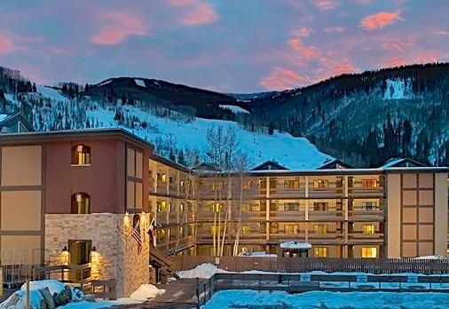Condo exterior with the ski slope in the background - Condo in Vail Village - Walk to the chairlift - Vail - rentals
