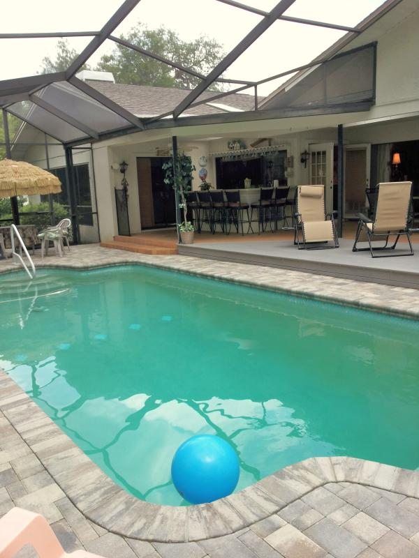 Pool area, outdoor bar seats 8, plus spa and 2 dining tables - Tropical Resort Home,Htd Pool/SPA Sleeps 12 - New Port Richey - rentals