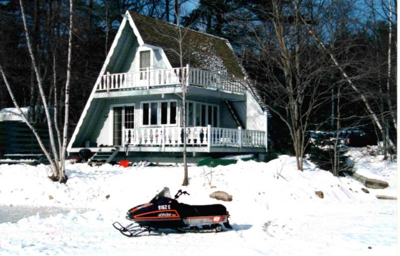 Wintertime view of chalet with ice rinks and trail - Lakefront and mountainside 3 br chalet - Bridgton - rentals
