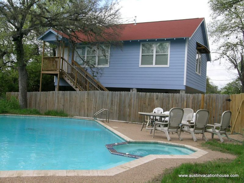 View of Guest House across the pool, yard, and patio - Gigabit Internet * Pet Frendly * Private Pool - Austin - rentals