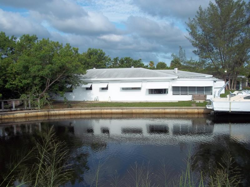 Outside view from canal - Canal/Seawall 10' From home w/palm & banana trees - Vero Beach - rentals