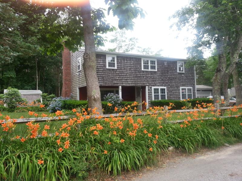 Front of house with front porch and street side day lily\\\\\\\\\\\\\\\'s - Private Home with 2 MBRs on Private Road and Beach - Barnstable - rentals