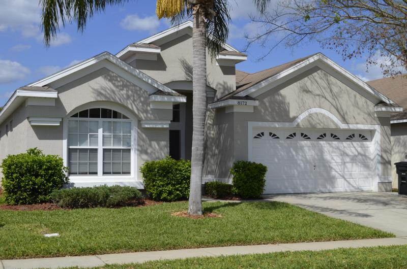 Front view with a Palm Tree at the front door - Steps to Disney, Vacation Pool Home, WIFI, BBQ, A - Four Corners - rentals