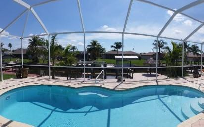 Solar heated pool - southern exposure overlooking the canal - Luxury waterfront villa with boat dock and lift! - Cape Coral - rentals
