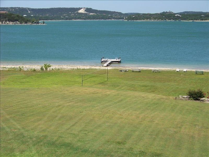 Volleyball court, dock, and beach.  This view is not visible from the house. - Beautiful Montina Beach on Lake Travis - Volente - rentals
