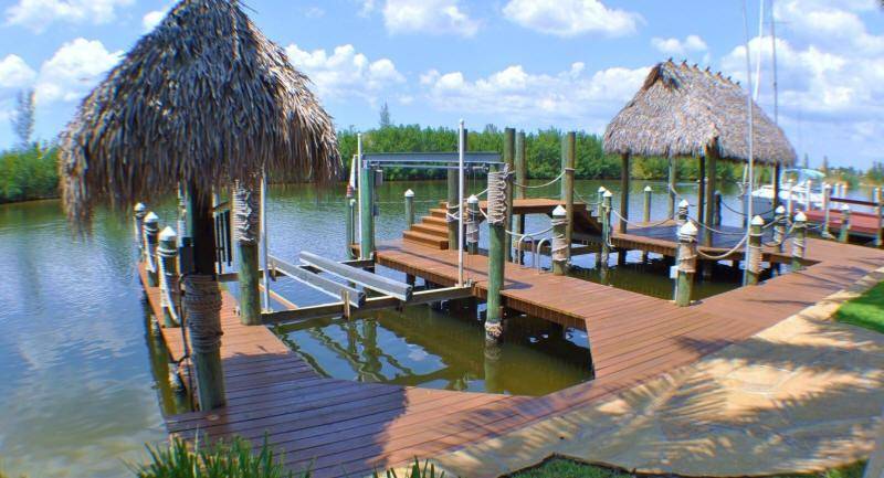 Dock of home with boatlift - Waterfront Gulf Access Home with Pool, Spa, Dock - Cape Coral - rentals