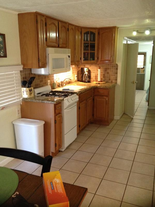 Kitchen w/Gas Stove & Oven, Microwave, Lighted Wood Cabinets/Granite Countertop - Vacation Resort Rental in the Florida Keys - Long Key - rentals
