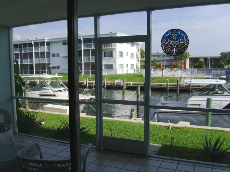 Enclosed patio overlooking waterway - Affordable, spacious,quiet 2 BR waterfront getaway - North Palm Beach - rentals