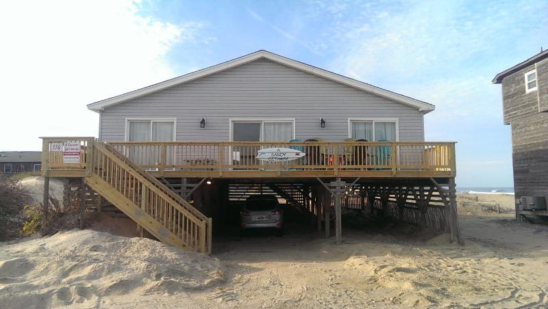 Front of house showing large and recently rebuilt deck. - Wonderful Ocean Views in This Cozy Beach Home - Nags Head - rentals